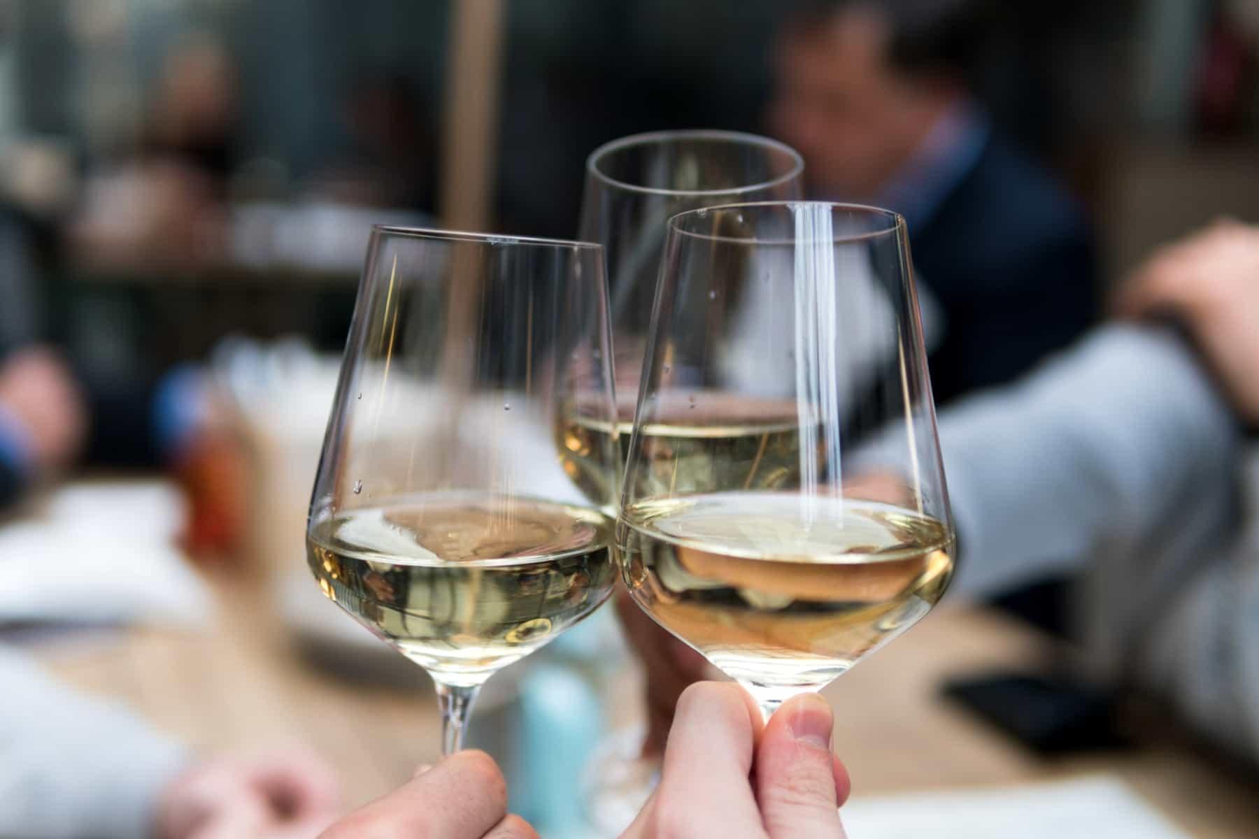 Three glasses of the driest white wine.