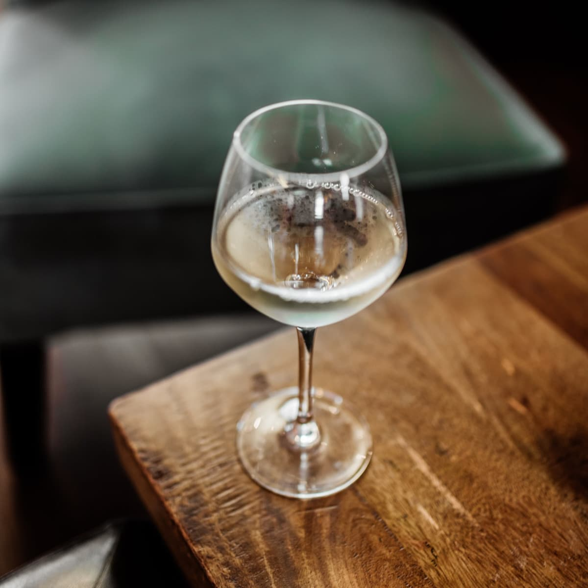 Glass of Chardonnay on a wooden table